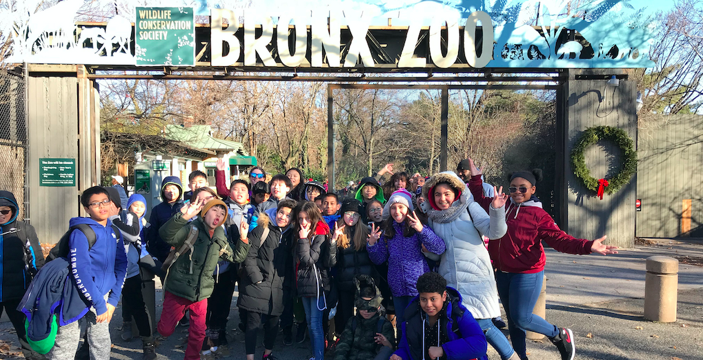 Group photo of 6th graders taken in front of Bronx Zoo